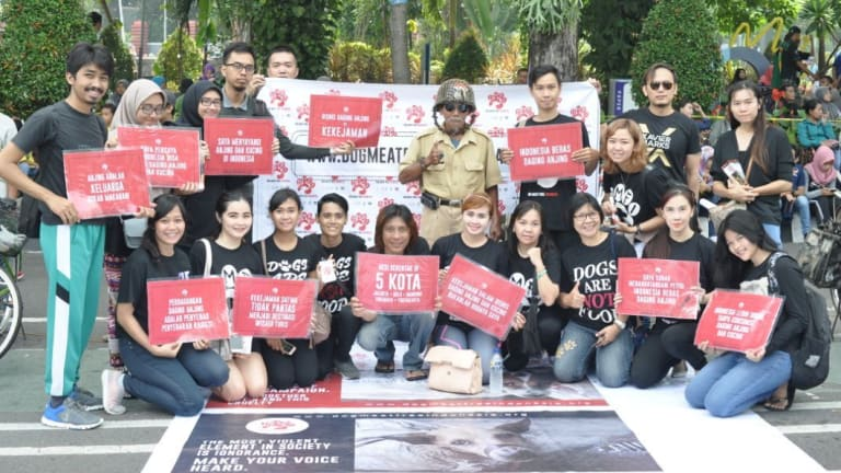 Members of the Dog Meat-Free Indonesia coalition protest against the killing of dogs for meat in their country.