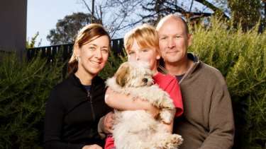 Matthew, Karen and Will Owen at home in Canberra with dogs Stella and Buddy.