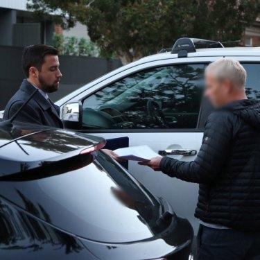 Detectives arrest Hamish McLaren in Bondi in July last year.