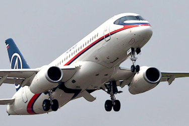 In this photo released by Sergey Dolya, a Sukhoi Superjet-100 takes off from Halim Perdanakusuma airport in Jakarta, Indonesia, Wednesday, May 9, 2012 on it's second demonstration flight of the day. The Russian-made Sukhoi jet plane with 50 people on board, including eight Russians and an American, has gone missing during this flight near Jakarta, Indonesian government officials said Wednesday.(AP Photo/Sergey Dolya) NO SALES Sukoi Superjet Russian made airliner