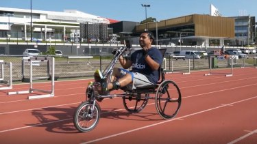 Dr Palipana, a quadriplegic, riding a bike using the BioSpine.