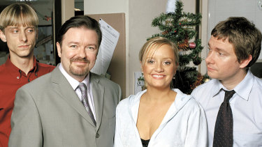 Mackenzie Crook as Gareth, Ricky Gervais as David Brent, Lucy Davis as Dawn and Martin Freeman as Tim in The Office.