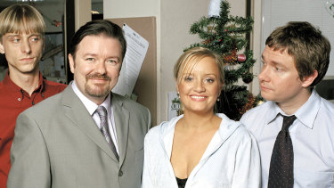 Ricky Gervais (second from left) in his role as needy and narcissistic office boss David Brent.
