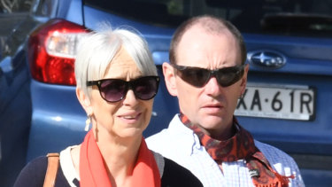 Ailsa Carr (left) and her husband Mark Fischer arrive at Lidcombe Coroner's Court.