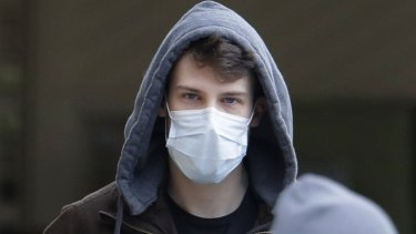 A man wearing a mask near Seattle, where several cases of COVID-19 have been confirmed. The mask has become a powerful symbol of a troubled world.