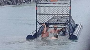 The men who were photographed in a crocodile trap near Port Douglas have been widely criticised.