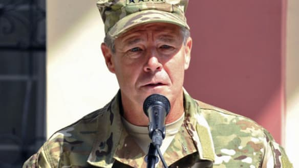 NATO commander escapes Taliban attack that killed Afghan police chief