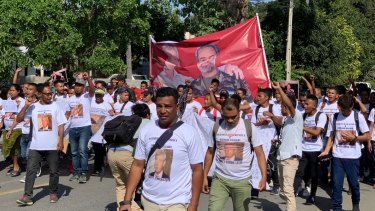 "Civil society group MKOTT March through the streets of Dili chanting ""Viva Timor Leste! Viva Bernard Collaery! Viva Witness K!"". They want the Morrison government to stop the prosecution of the whistleblowers."