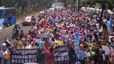 About 2000 people march in Indonesia earlier this month to push for a law to eradicate sexual violence.