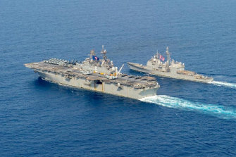 US Navy ships passing through the South China Sea where China is flexing its muscle during the pandemic.