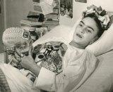 Frida Kahlo in hospital bed holding decorated skull, c1950s, gelatin silver print, 20.3 x 25.4 cm. Courtesy of Throckmorton Fine Art, Inc, Juan Guzman.