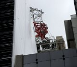 The jib of a crane at a work site in North Sydney collapsed on Sunday, leaving three people in hospital.