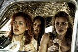 Three of the Five Wives, Riley Keough, left, as Capable, Courtney Eaton as Cheedo the Fragile, and Rosie Huntington-Whiteley as The Splendid Angharad.