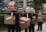 Environmental activists perform representing leaders, including Australia's Prime Minister Tony Abbott, at climate talks in Lima.
