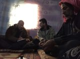 Richard Flanagan interviews refugees during his journey with Ben Quilty.