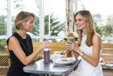 Superfood smoothies were the order of the day for Lara Worthington (left) and Kater Waterhouse.