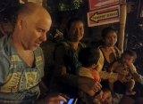 Michael Bachelard on a roadside in Kuta beach, Bali, interviewing street beggars.