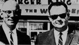 David Edgerton, right, with his Burger King partner, James W. McLamore in front of a Burger King store.