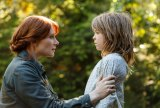 Bryce Dallas Howard is Grace and Oakes Fegley is Pete in Disney's Pete's Dragon, the adventure of an orphaned boy and his best friend Elliot, who just so happens to be a dragon.