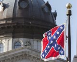 The Confederate battle flag flies on the grounds of the State House in Columbia, South Carolina, for the final time on July 10, 2015.