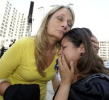 Cheryl Blades hugs a lady who asked not to be identified after the sentencing. The lady was treated by Fata while she was pregnant twice and is still treated for an unknown condition.