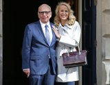 The deal featuring two separate arms of Rupert Murdoch's empire was struck at the same time as Mr Murdoch married Jerry Hall over the weekend.