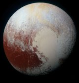 Pluto has reddish patches, showing likely interesting chemical activity on its frozen surface.