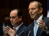 French President Francois Hollande and Prime Minister Tony Abbott at a press conference at Parliament House, in Canberra.