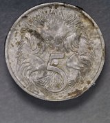 A five cent coin after its 1966 ordeal.