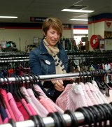 Mrs Abbott browsing for second hand clothes after launching the National Op Shop Week at the Salvation Army store in Manly in 2014.