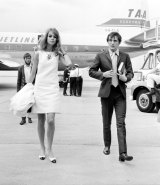 English model Jean Shrimpton and her companion, actor Terence Stamp, arriving at Essendon Airport for  Melbourne Cup week on October 30, 1965.