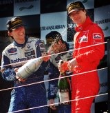 Winner of the 1996 Grand Prix, Damon Hill of Britain, sprays champagne on compatriot, and third place getter Eddie Irving.