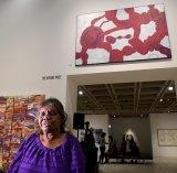 2017 Wynne Prize winner Betty Kuntiwa Pumani with the painting ANTARA.