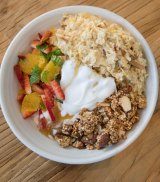 The bircher is kombucha-soaked muesli with sliced apple, coconut flakes, strawberries and yoghurt.
