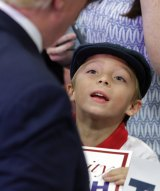 A young boy looks up at Donald Trump during a campaign stop Monday in Tennessee.