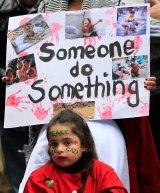 A young girl attends a pro-Palestine rally in Sydney's CBD on Sunday.