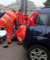 Italian paramedics treat a wounded man.