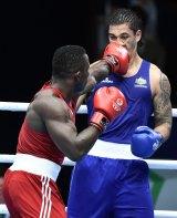 Nigeria's Efetobor Apochi lands a punch on Australia's Jai Opetaia.
