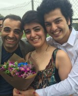 Mojgan Shamsalipoor after her release from detention in September 2016, with her brother Hossein and husband Milad Jafari.