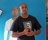 Myuran Sukumaran in Kerobokan prison with one of his self portraits.