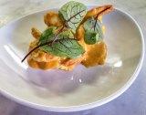 The tiger prawns, romesco and kipfler potato dish at Bellota.