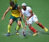 Andrew Philpott of Australia battles for the ball with Gurwinder Chandi of India.
