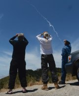 Spectators watch an interceptor missile launch from an underground silo at Vandenberg Air Force Base.