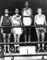 Olympic glory: Cassius Clay on top of the podium at the Rome Olympics. Tony Madigan (second from left) won bronze.