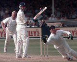 Alec Stewart is bowled by Shane Warne and caught by Ian Healy during the fifth Test at Trent Bridge, Nottingham,  England in 1997.  Australia scored 427 runs in the first innings.  (AP Photo/Rui Vieira)