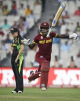 Deandra Dottin throws the bat skyward after the West Indies won the tournament with just three balls to spare.