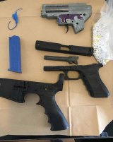 Some of the replica firearms allegedly seized by police.