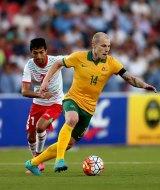 International star: Aaron Mooy on the run against Tajikstan in September.