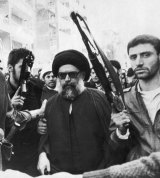 Lebanese Shiite leader Mohammed Hussein Fadlallah is flanked by bodyguards in March 1985 as he attends a funeral ceremony in Beirut for more than 75 people killed in an attempt on his life. The attack is believed to have been carried out by Saudi agents at the CIA's instigation.