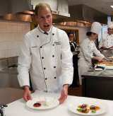 Are there any oysters in this? Prince William tries his hand at cooking during a Royal tour of Canada in 2011.